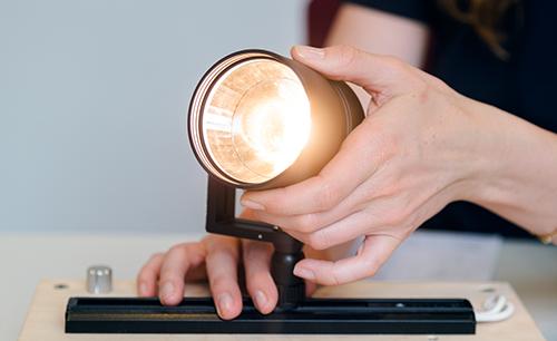 Hand directing a light